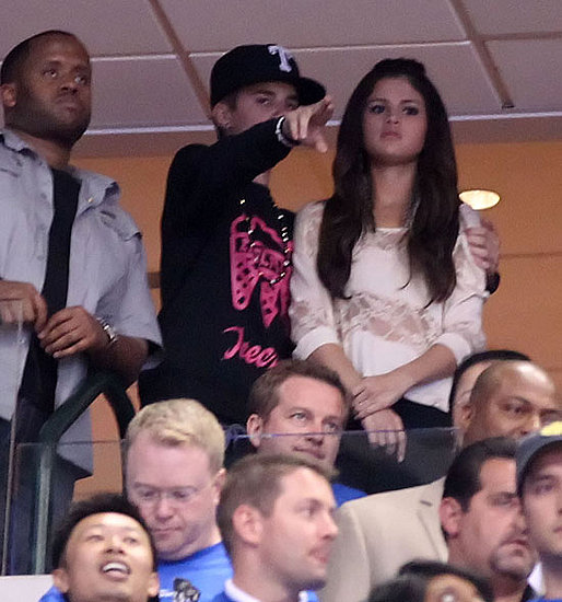 justin bieber pictures. Justin Bieber and Selena Gomez Kissing Pictures at a Basketball Game